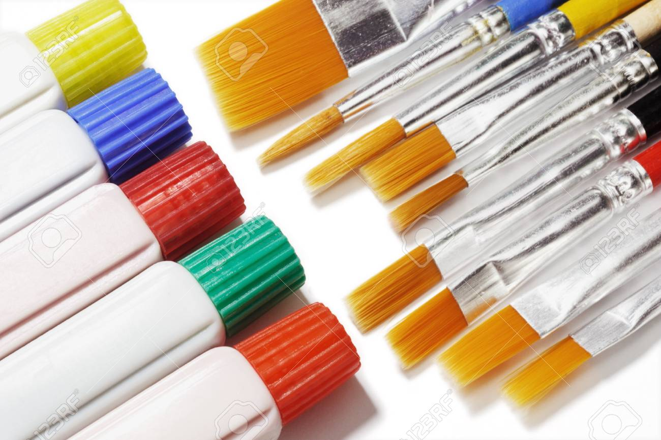 Tubes of color paints and brushes of assorted sizes on white background Stock Photo - 9768399