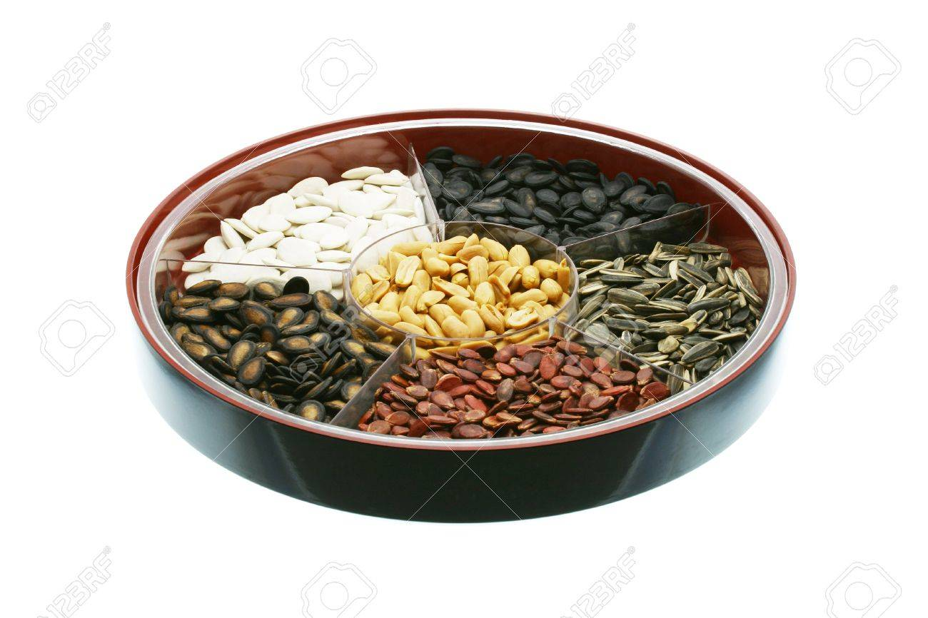 Chinese New Year snacks - assorted seeds and nuts on white background Stock Photo - 10372492