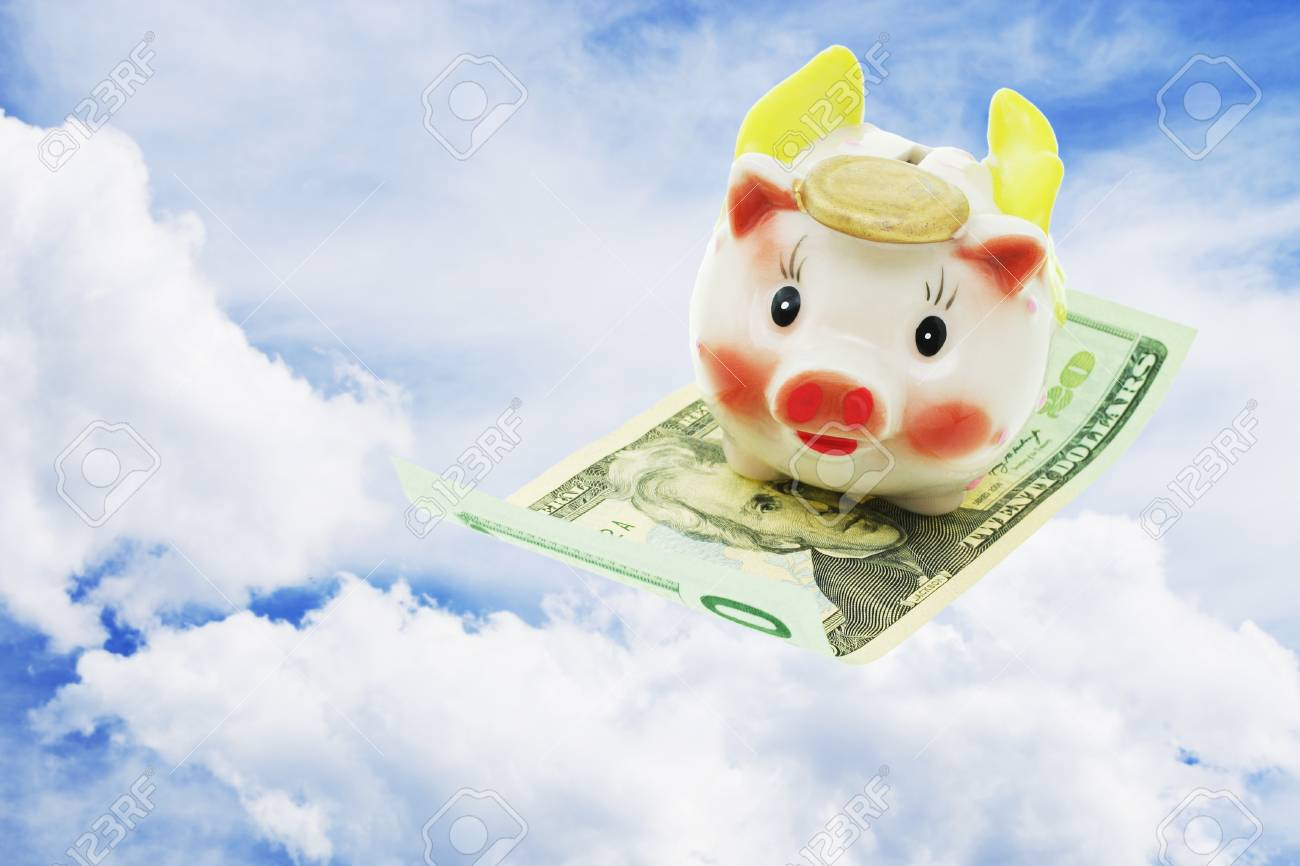 Flying piggy bank riding on US 20 dollars note on open sky Stock Photo - 10388387