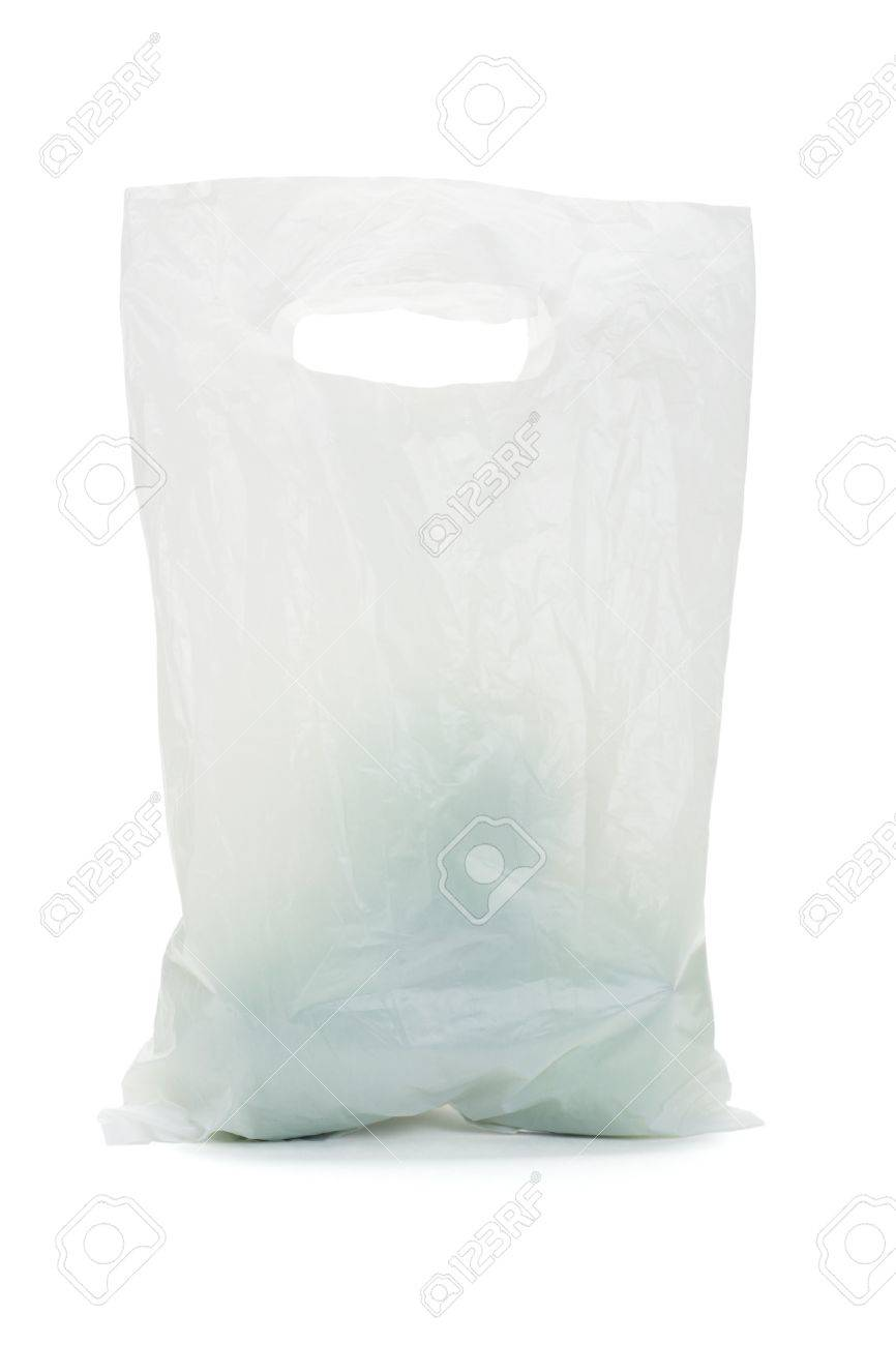 White opaque plastic bag containing green apples on isolated background - 10641173