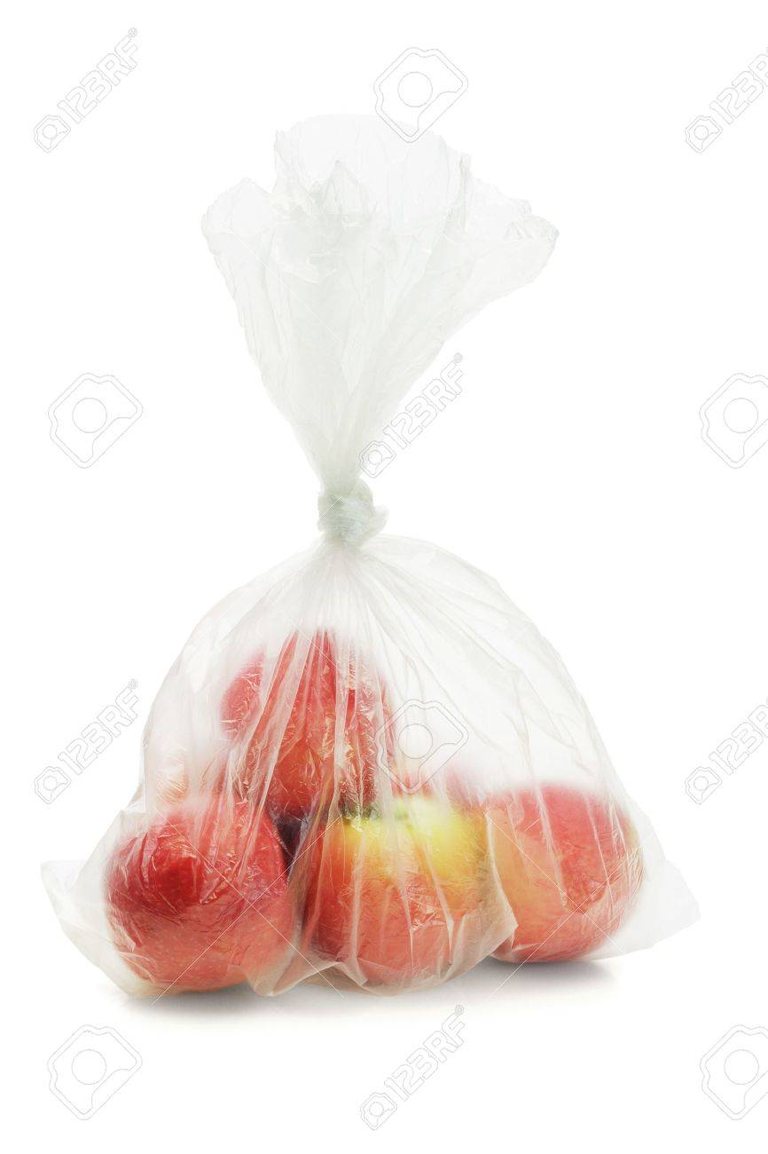 Red apples in translucent plastic bag on white background - 10779253