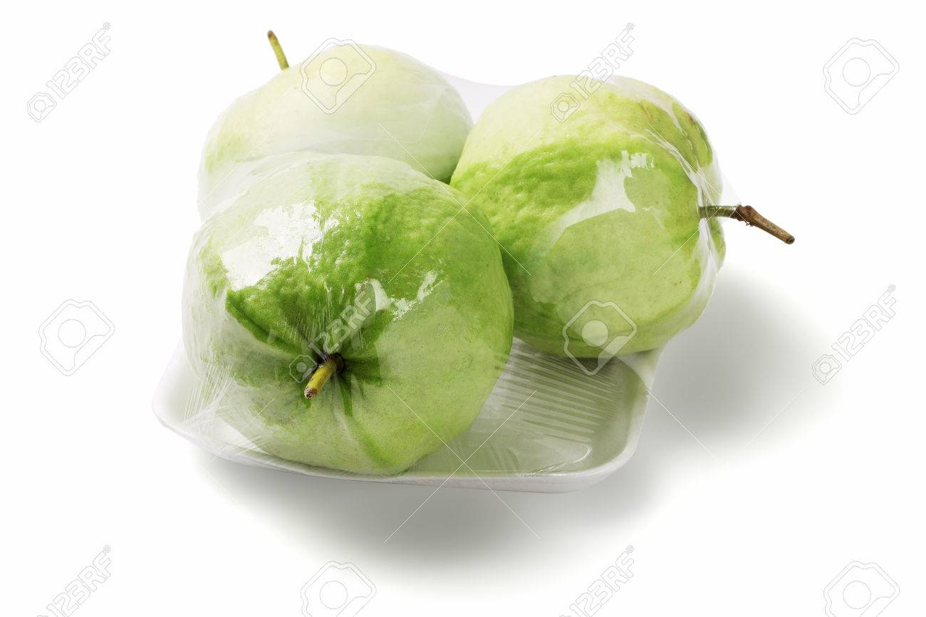 Three Guava Fruits In Cellophane Wrap On White Background Psidium