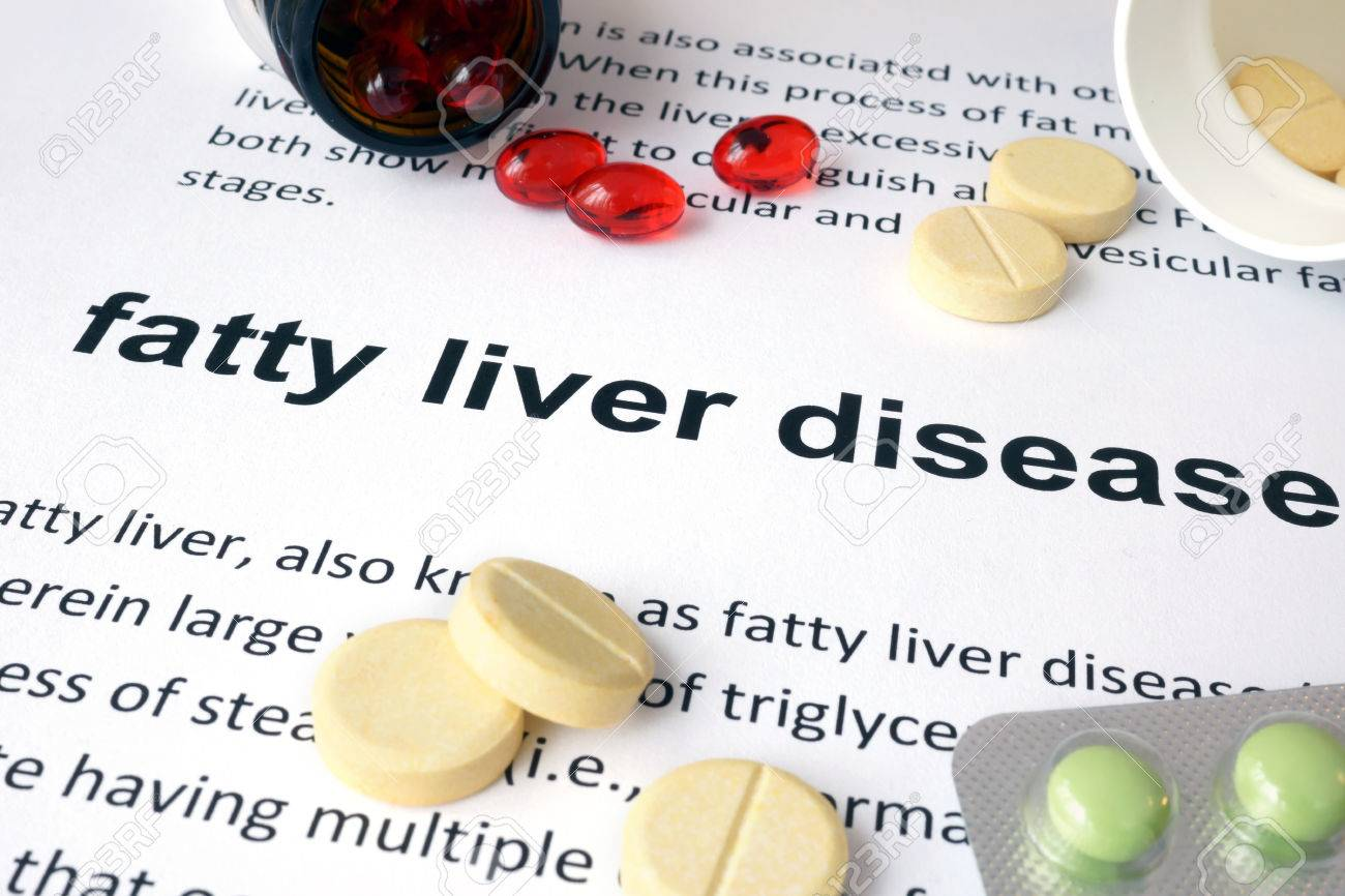 Paper with fatty liver disease and pills. - 39659400