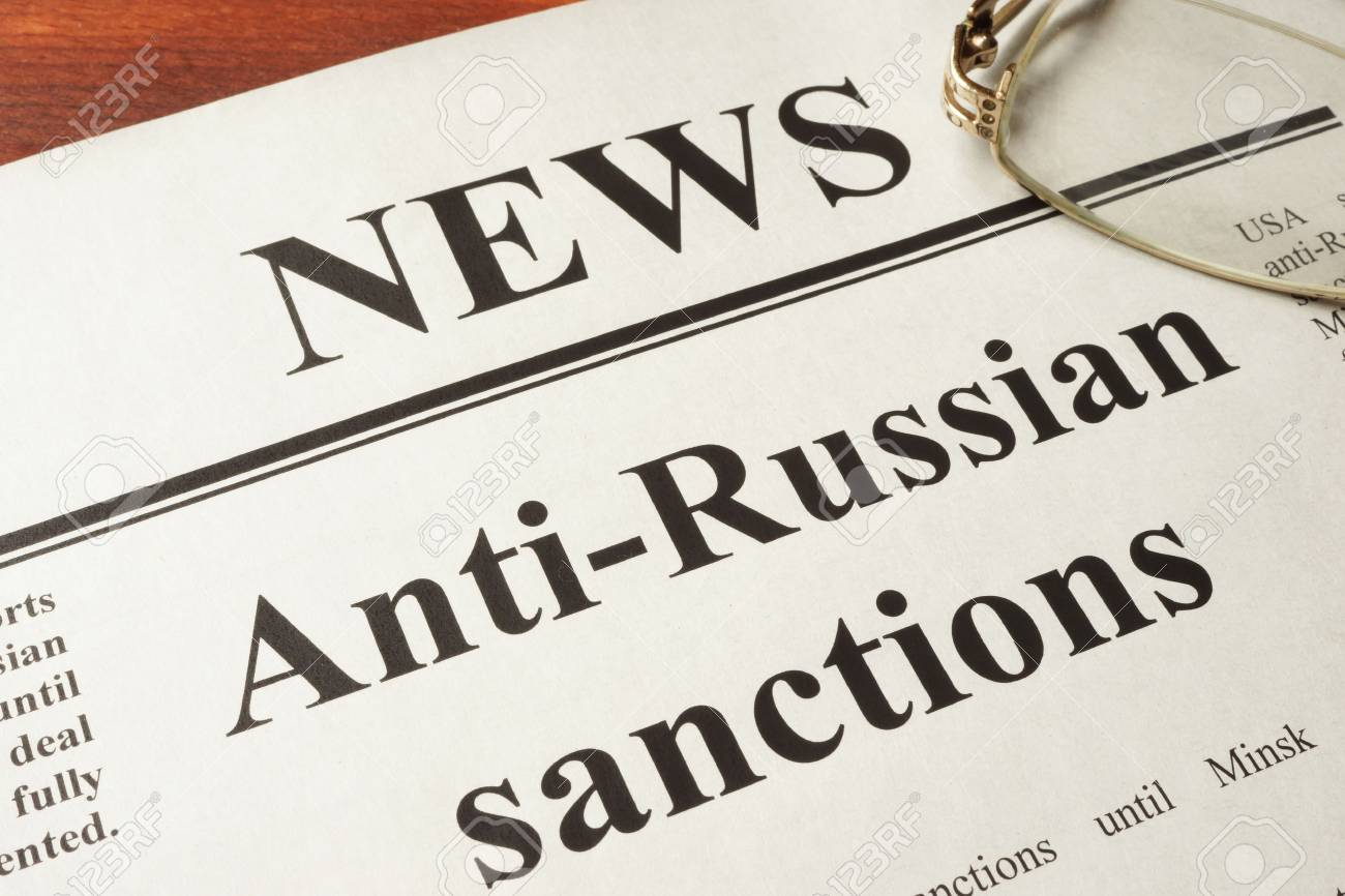 Newspaper with word news and Anti-Russian sanctions. - 59156256