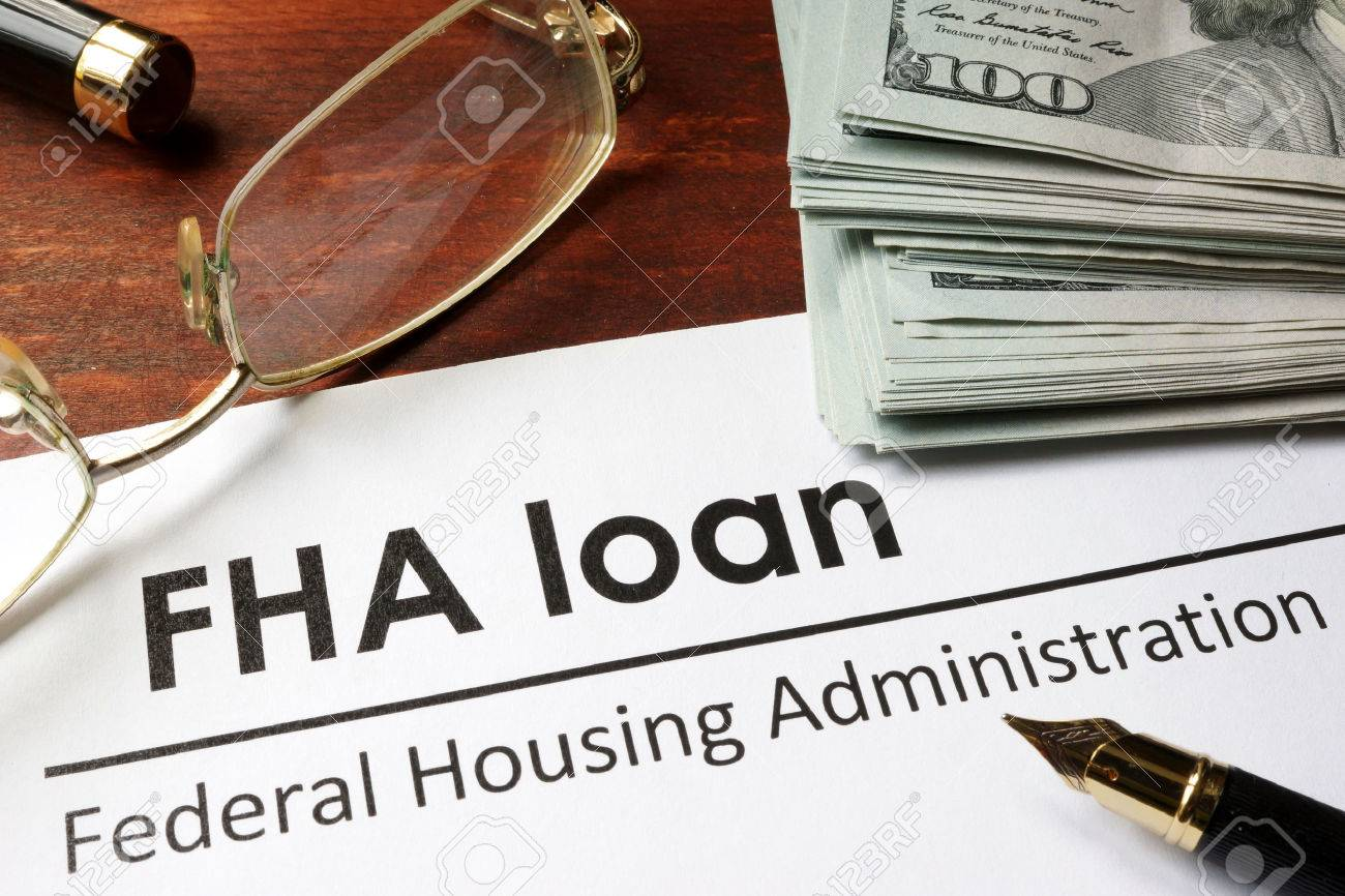 Paper with words fha loan on a wooden background. - 59156267