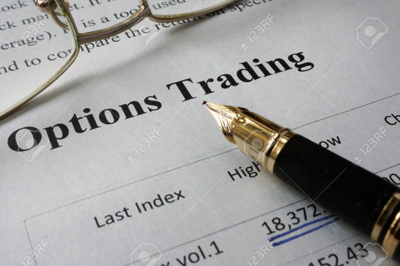 Page of newspaper with words options trading. - 60526898