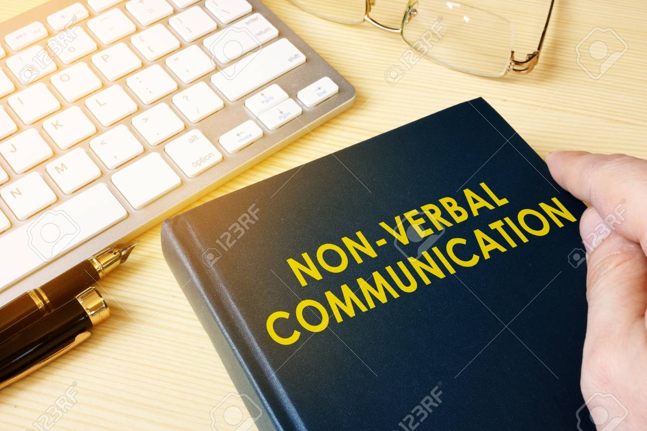 Book about NVC Non-verbal communication on a table. - 93215177