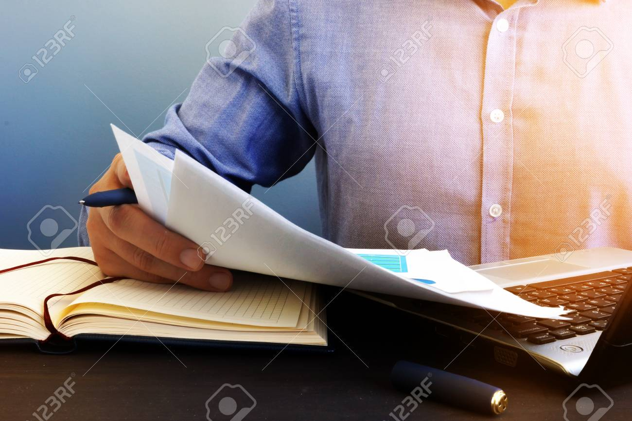 Auditor checking financial report. Paperwork in the office and audit. - 106627547