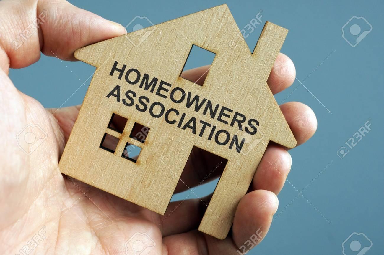 Homeowners Association HOA written on a model of home. - 116482647