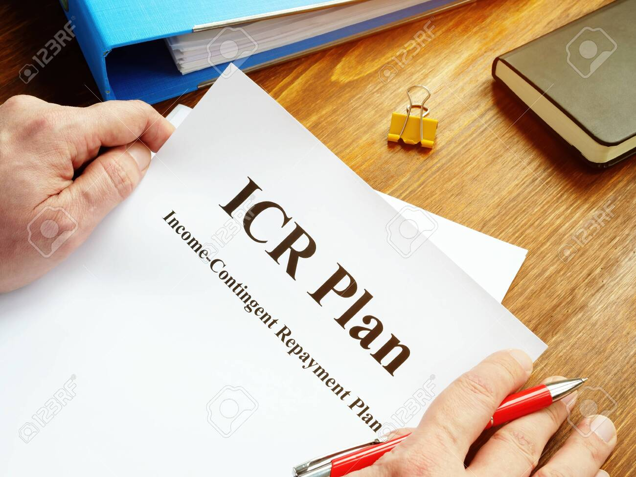 Man reads ICR Income-Contingent Repayment Plan. - 140778713