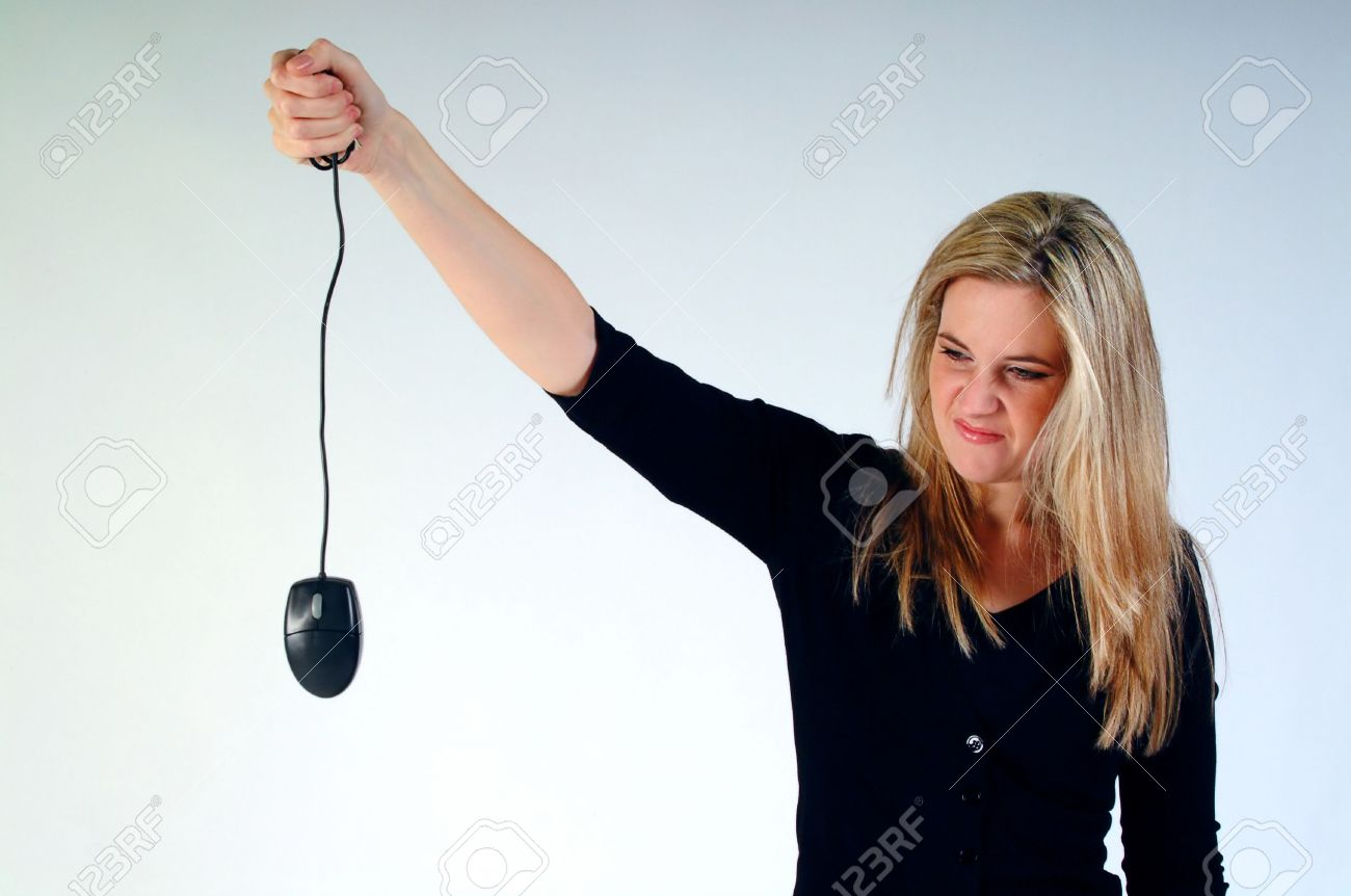 Girl holding a dead computer mouse. Stock Photo - 661447