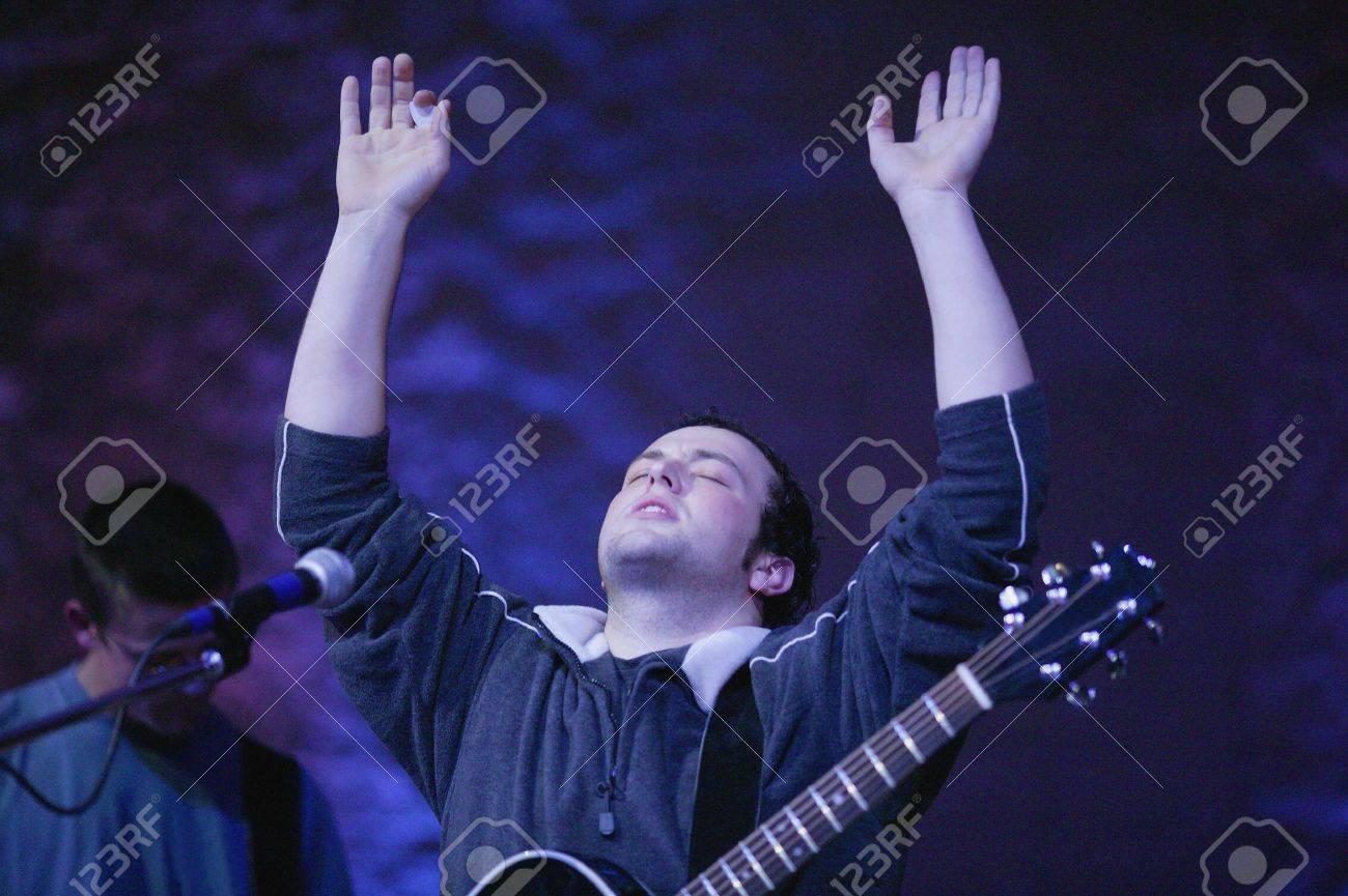 Man raising hands in worship Stock Photo - 6213139