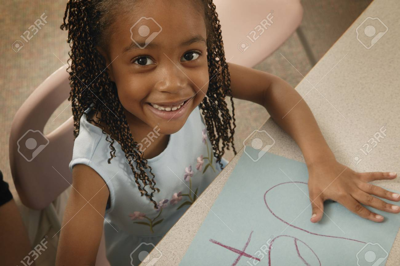 Girl colors a picture Stock Photo - 6214424