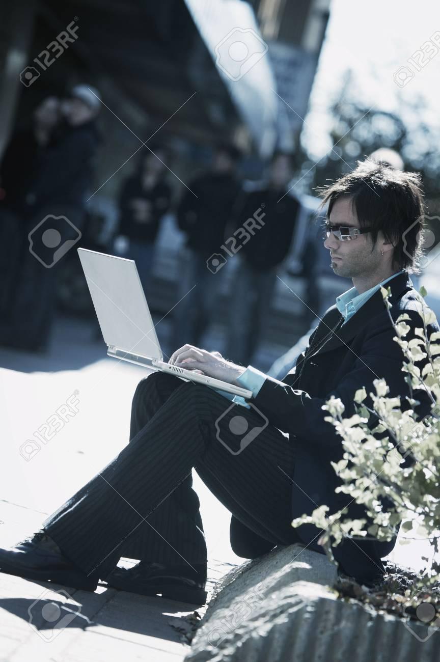 Man working on lap top Stock Photo - 5637586