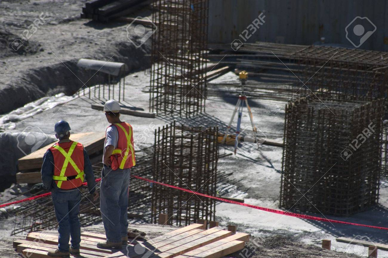 Building site and two construction workers Stock Photo - 6214370