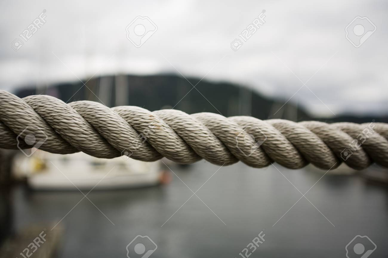 Close up thick rope, with fishing boats in background Stock Photo - 7183766