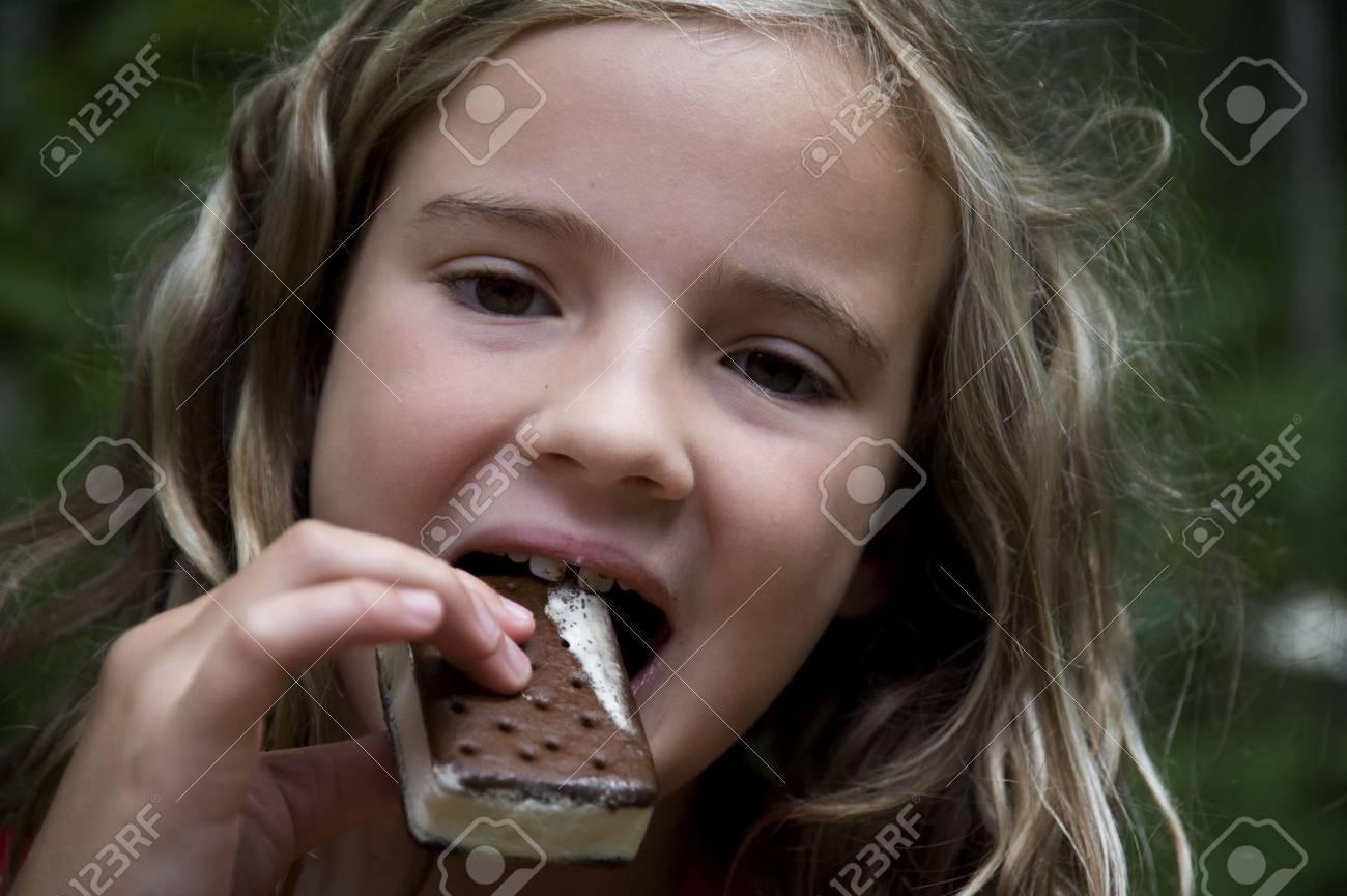 Girl eating ice cream bar, Lake of the Woods, Ontario, Canada Stock Photo - 7192081