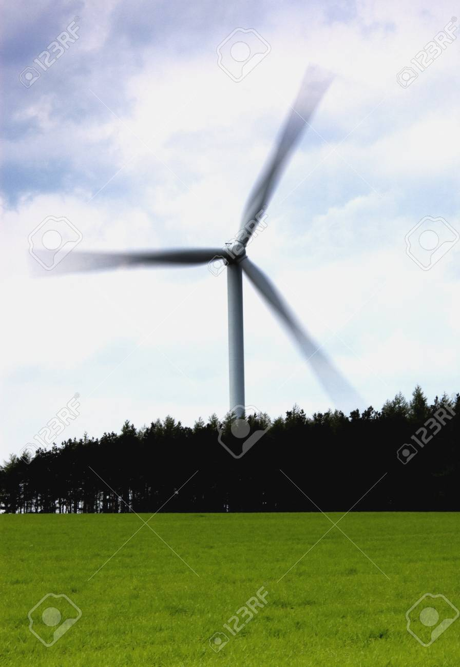 Wind turbine behind a field of grass, North Yorkshire, England Stock Photo - 7196088