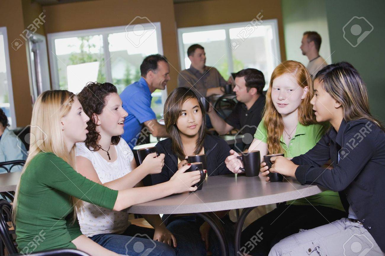 Group of friends visiting in restaurant Stock Photo - 7194456