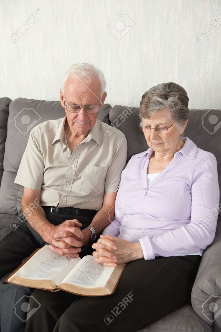 An elderly couple having worship with the Bible Stock Photo - 7192369
