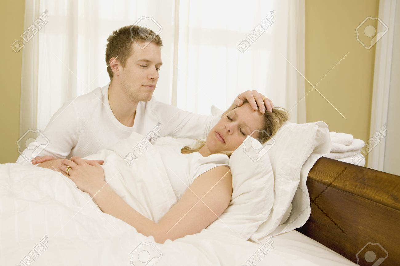Loving Husband Caring For Sick Wife In Bed Stock Photo Picture And