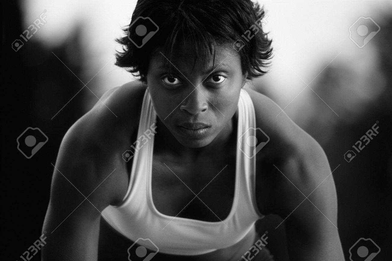 Black and white of woman at sprinter's starting blocks Stock Photo - 7192040