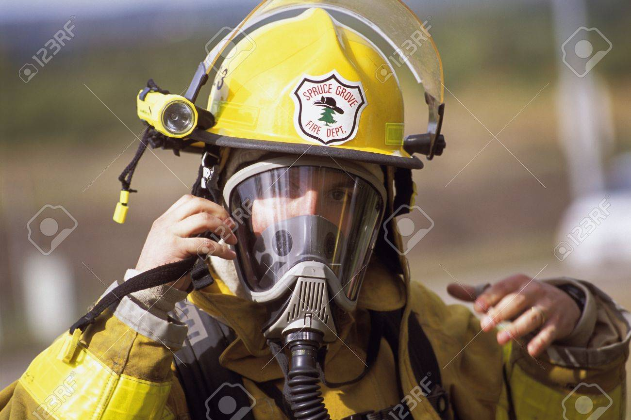 fireman adjusting mask stock photo picture and royalty free image