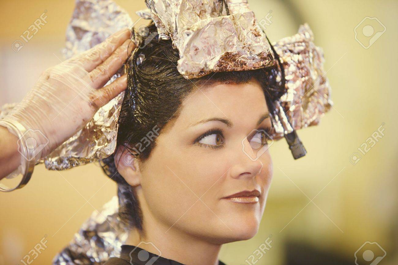 Woman having her hair dyed Stock Photo - 7190856