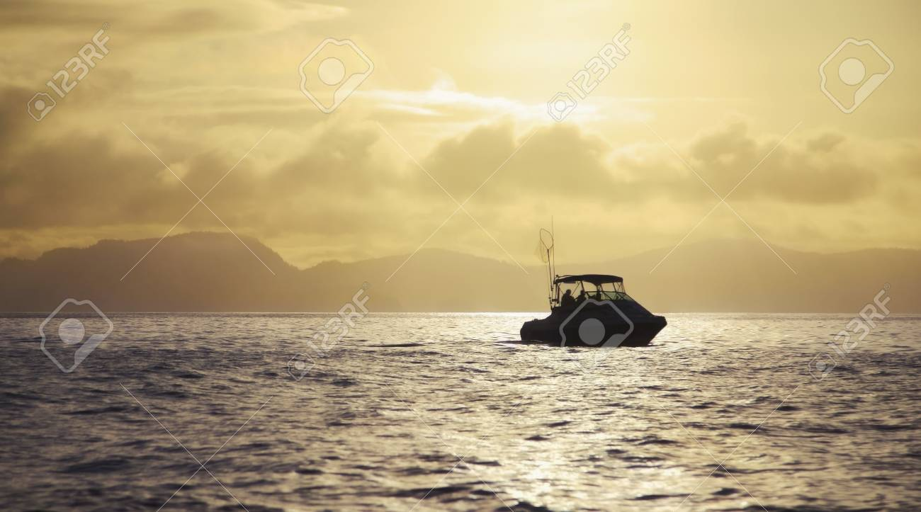 Boat on water at sunrise Stock Photo - 7191864