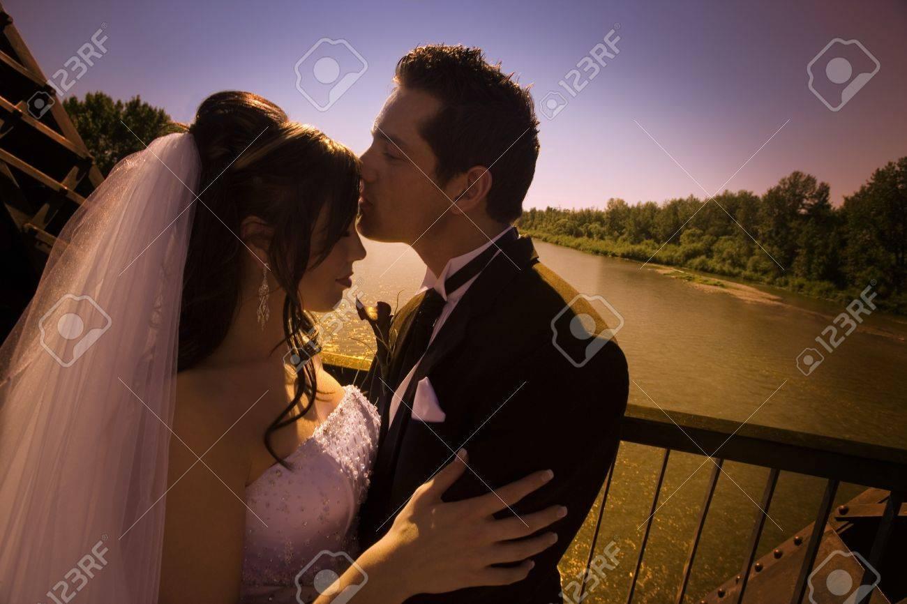 Groom kissing bride Stock Photo - 7192218