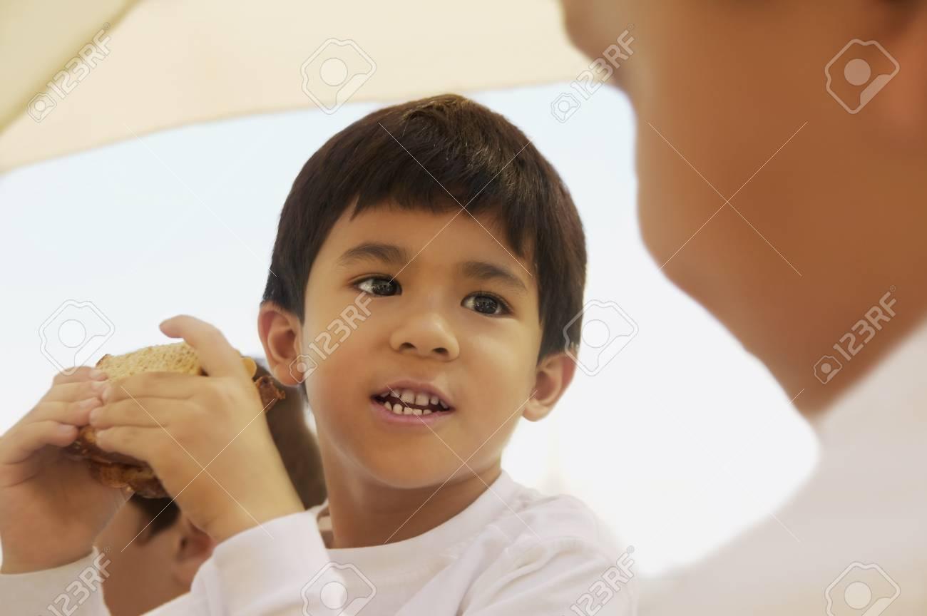 Boy eating a sandwich Stock Photo - 7192946