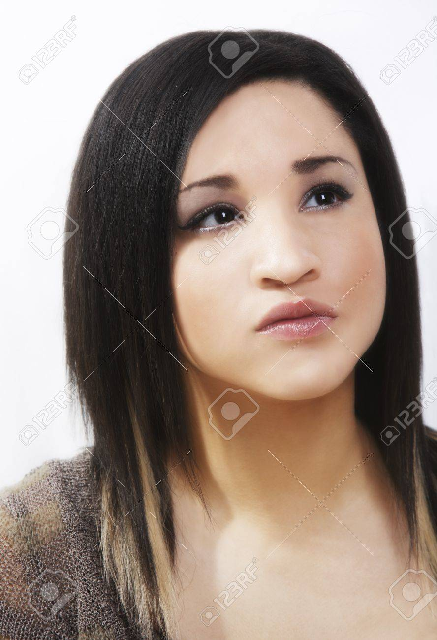 Young woman looking worried Stock Photo - 7200398