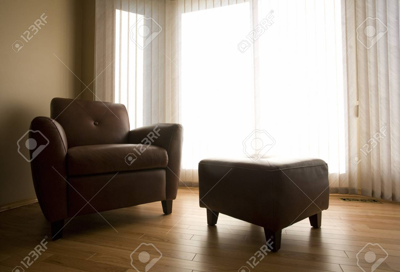 Living room with armchair and ottoman Stock Photo - 7202546