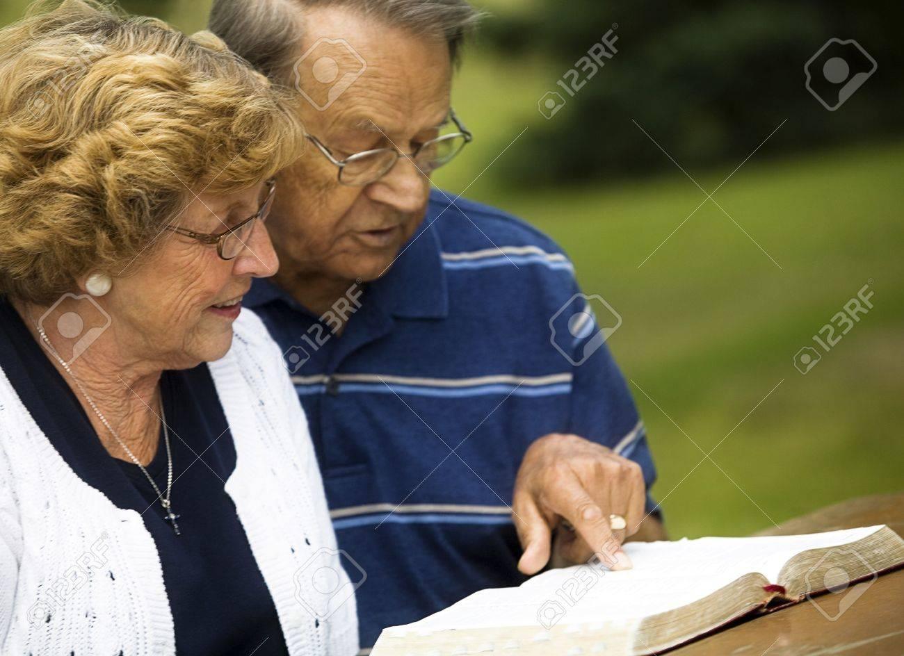 Senior couple reading the Bible Stock Photo - 7208241