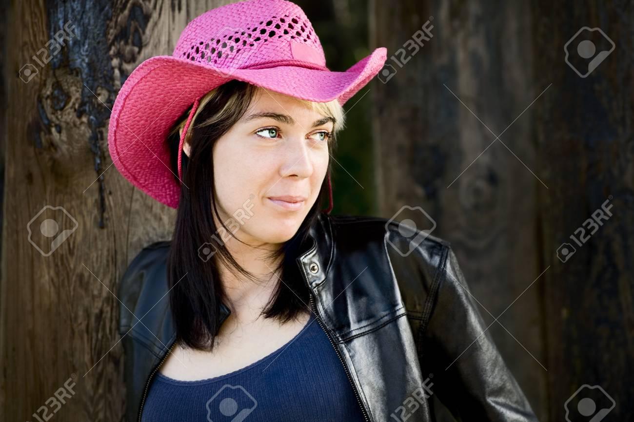 Woman wearing pink cowboy hat Stock Photo - 7208518 a800875e7691