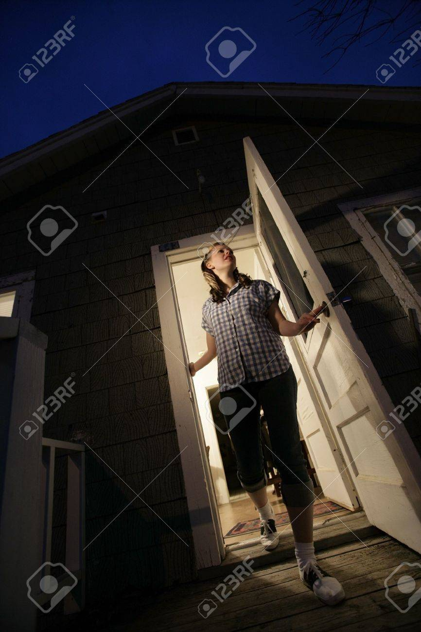 Woman stepping out of a house Stock Photo - 7208521 : door stepping - Pezcame.Com