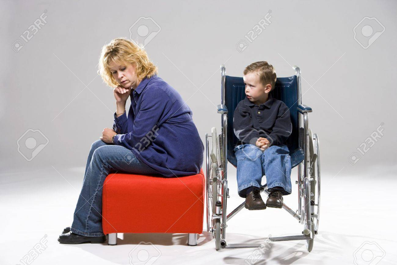 Mother with son in wheelchair Stock Photo - 7206692