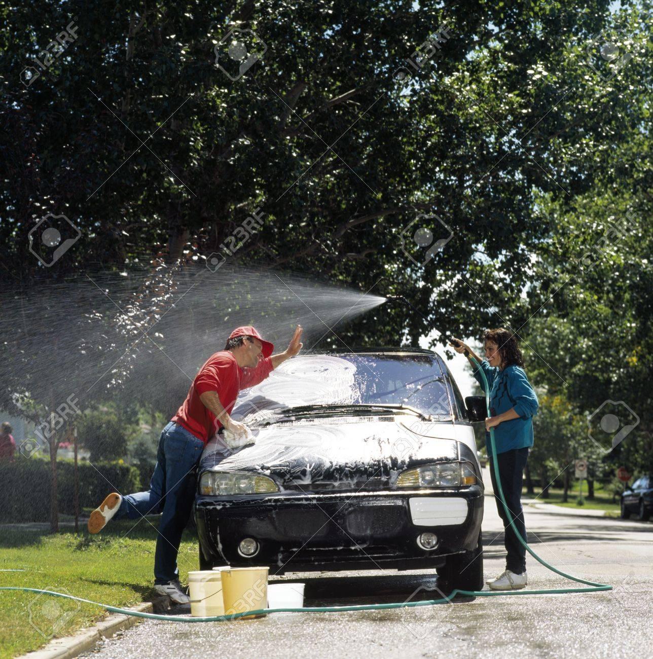 Couple washing the car Stock Photo - 7211039