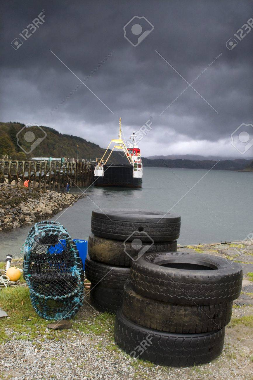 Used tires and lobster traps on waters edge,Lochaline,Scotland Stock Photo - 7209083
