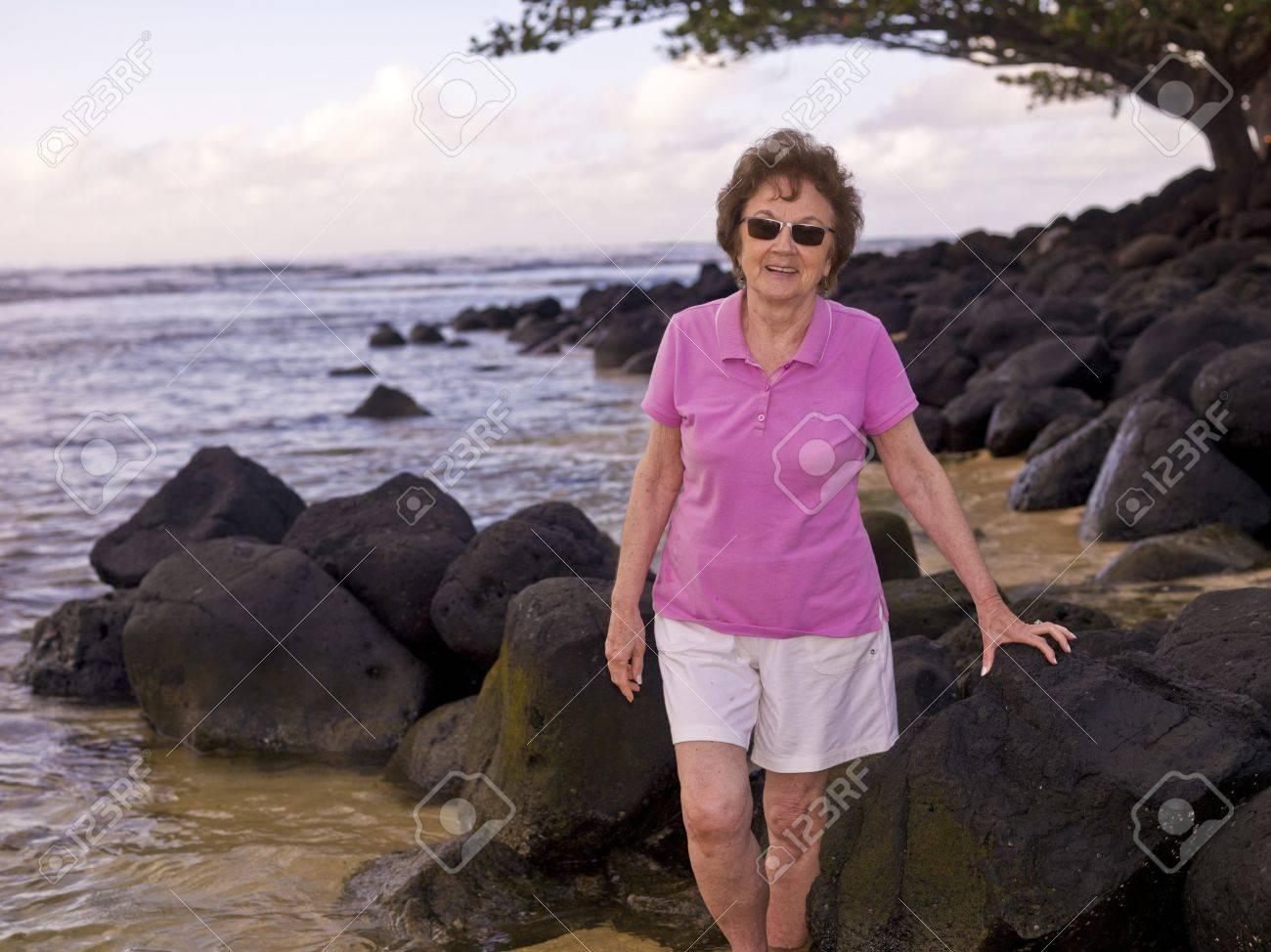 Woman on a rocky beach, Kauai, Hawaii, USA Stock Photo - 7208221
