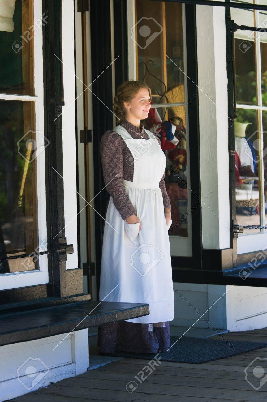 Young woman standing in store doorway Stock Photo - 7206770