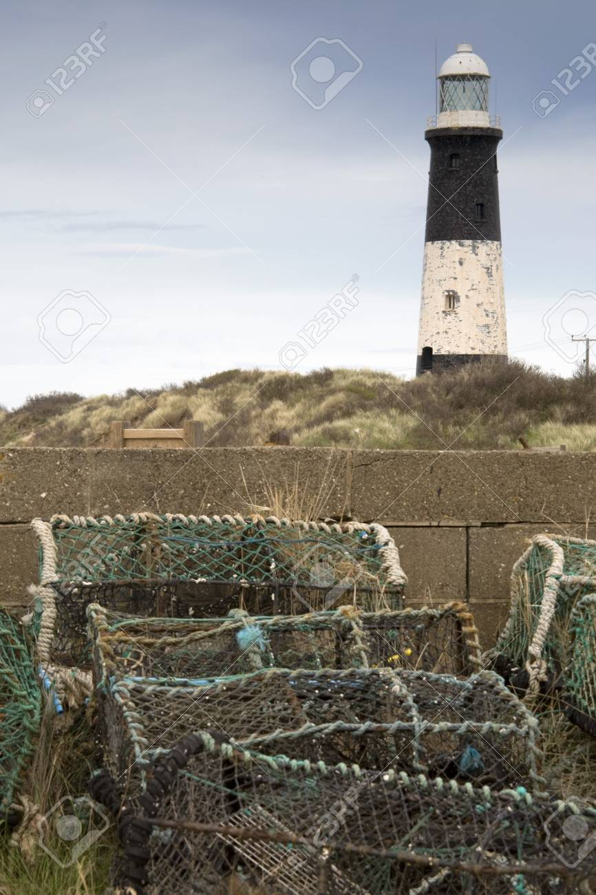 Lighthouse and lobster traps,Humberside,England Stock Photo - 7207067