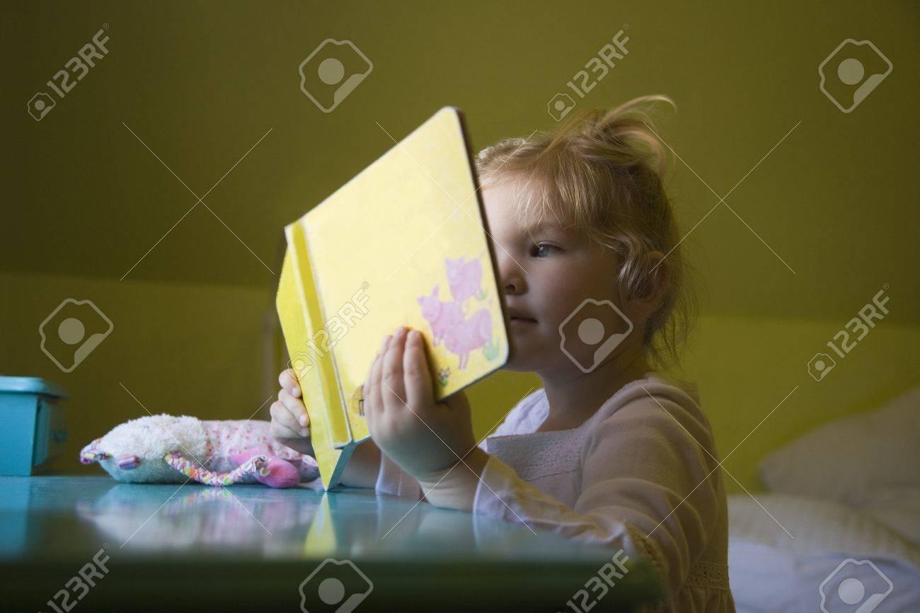 A girl reading a book Stock Photo - 7208577