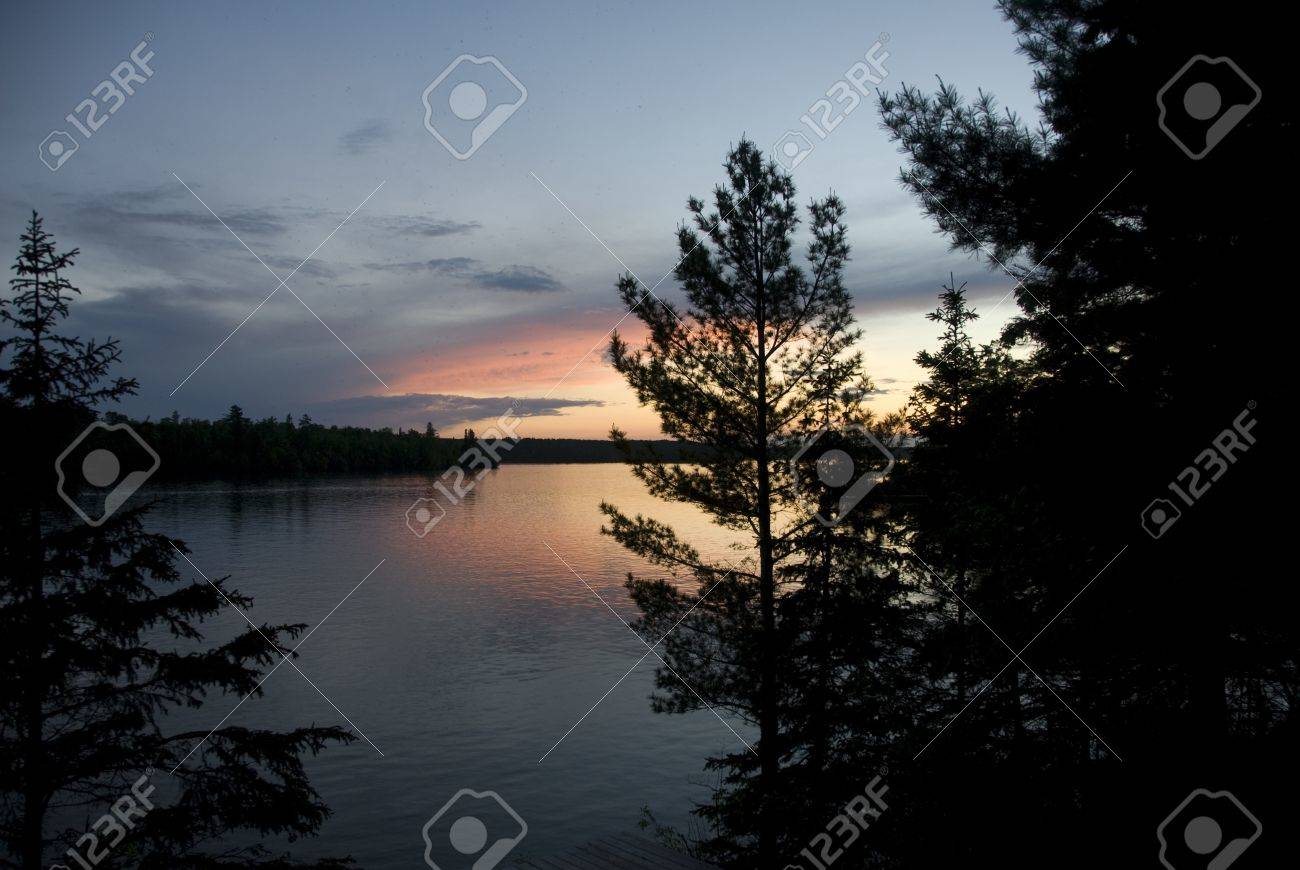 Lake of the Woods, Ontario, Canada; Majestic sunset over placid lake Stock Photo - 7551591