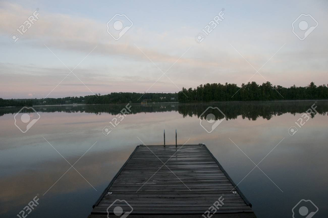 Lake of the Woods, Ontario, Canada; Pier leading to lake Stock Photo - 7551708