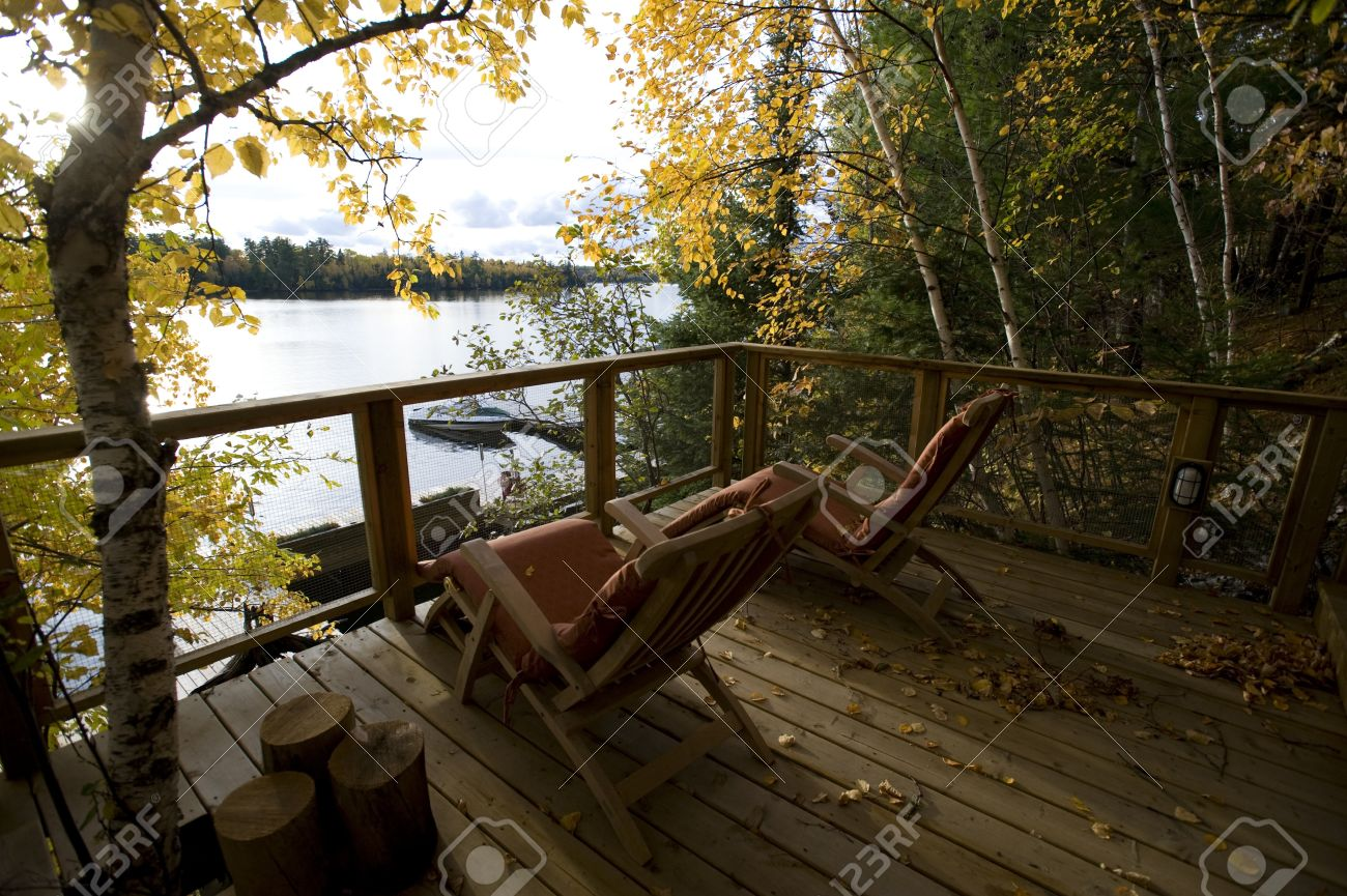 Cottage deck and autumn foliage, Lake of the Woods, Ontario, Canada Stock Photo - 7551779