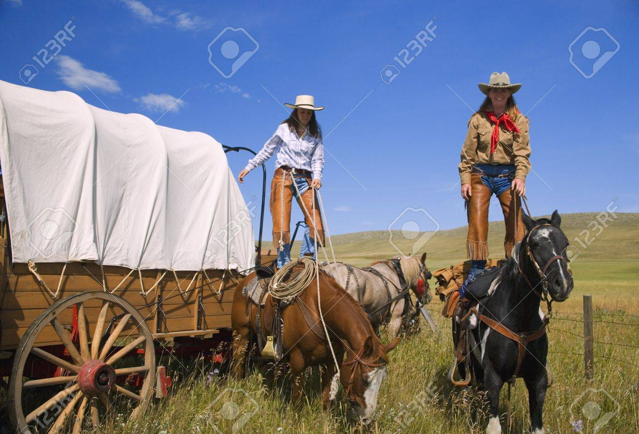 Cowgirls standing on horses Stock Photo - 7551796