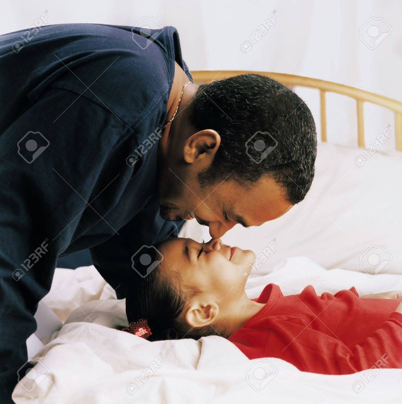 Father and daughter being affectionate Stock Photo - 7559359