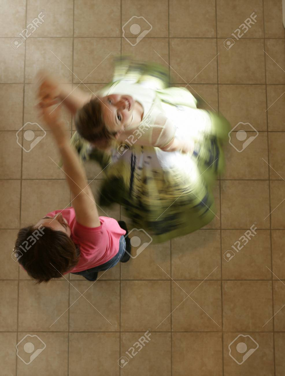 Mother and daughter dancing Stock Photo - 7559437