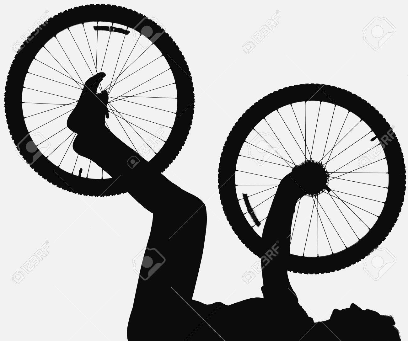 Silhouette of person holding bicycle wheel Stock Photo - 8241151